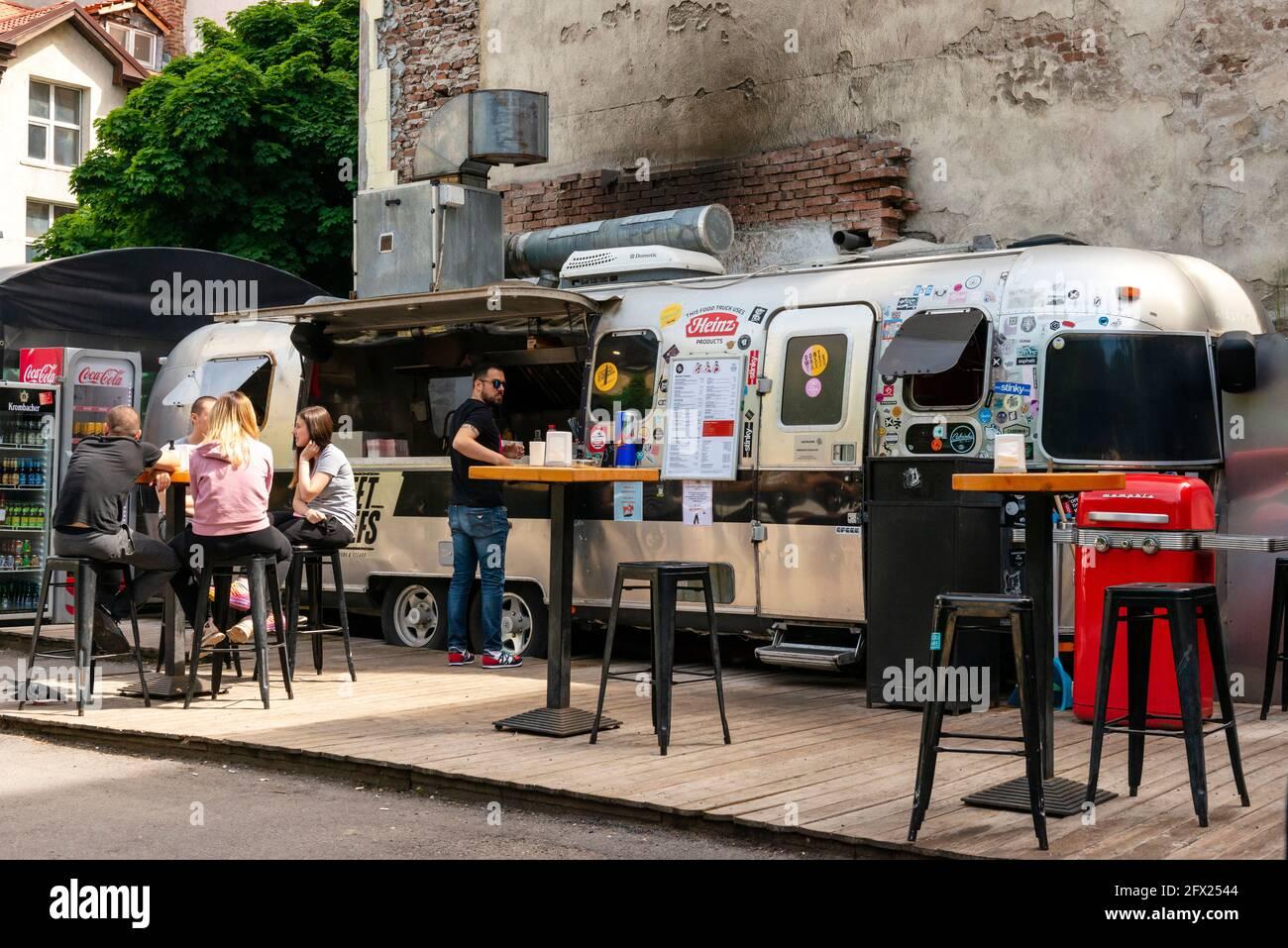 Green coffee van Serving customers on the promenade
