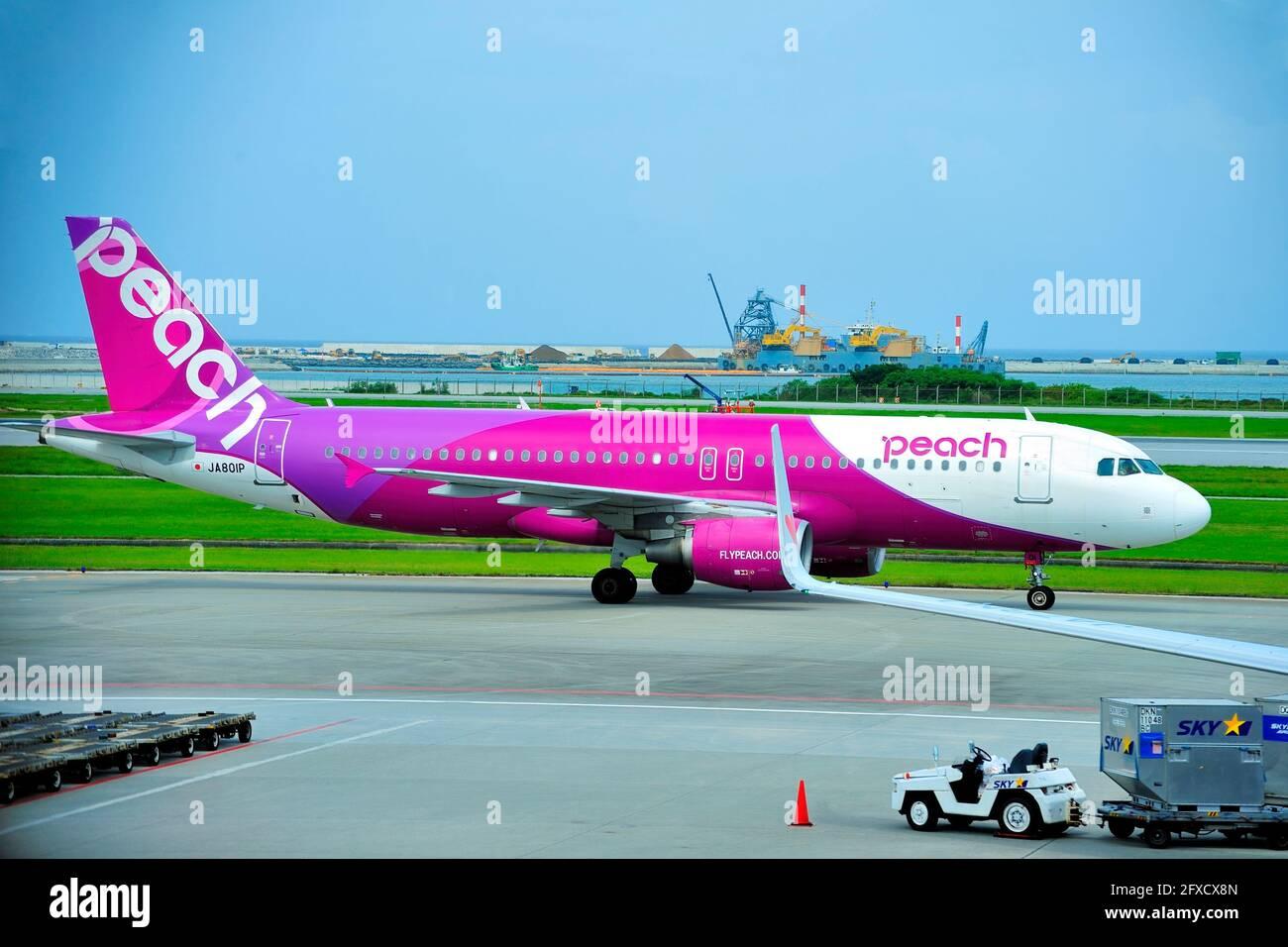 Peach, Airbus A320, JA810P, Taxiing to TO, Naha Airport, Naha, Okinawa, Ryukyu Islands, Japan Stock Photo