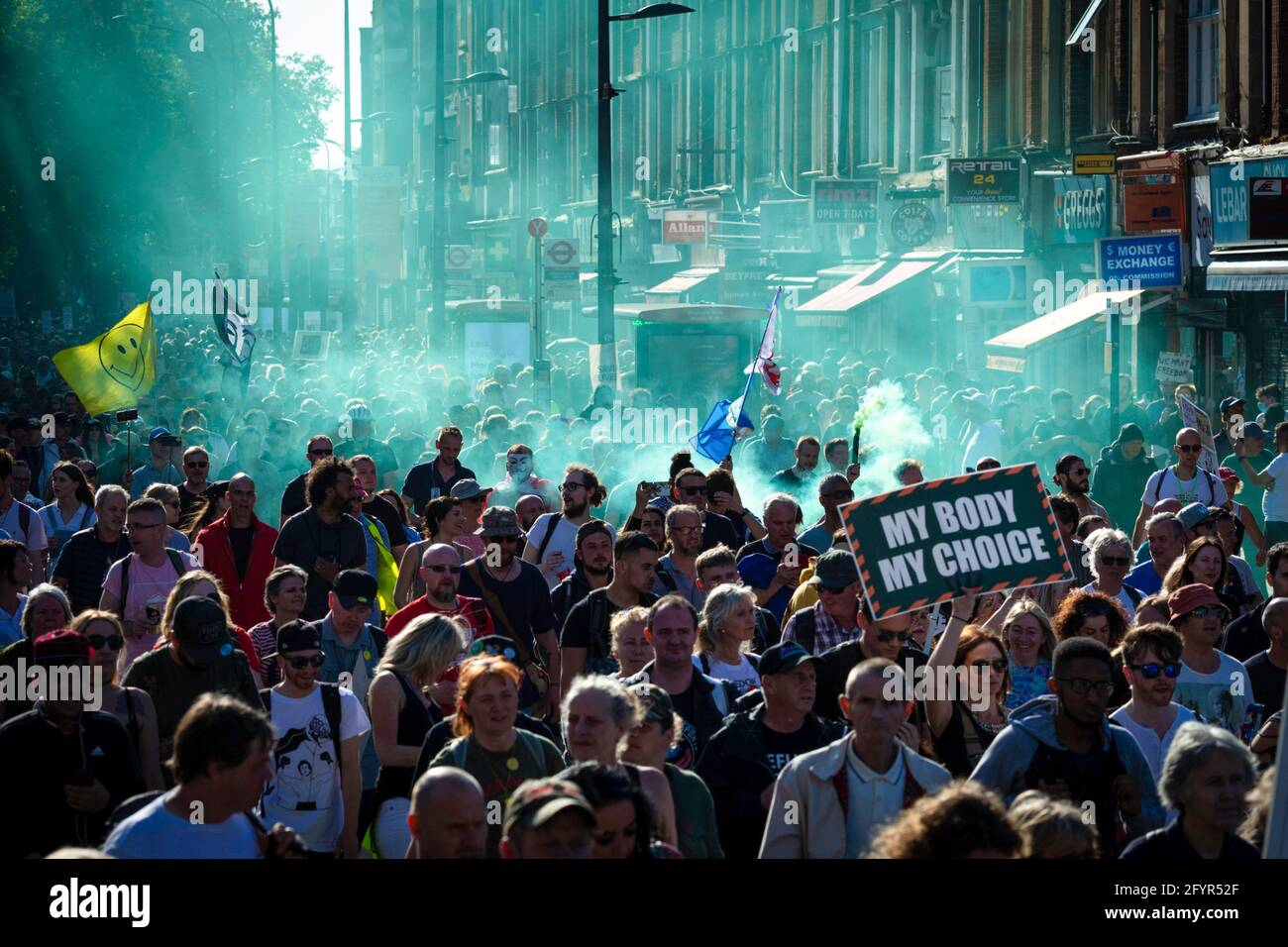 London, UK. 29th May, 2021. People march through the city during an anti-lockdown protest. Thousands of people came out under the banner to Unite for Peace and their Human Rights. The number of people attending the protests has increased month on month since the introduction of the COVID-19 restrictions. Credit: SOPA Images Limited/Alamy Live News Stock Photo