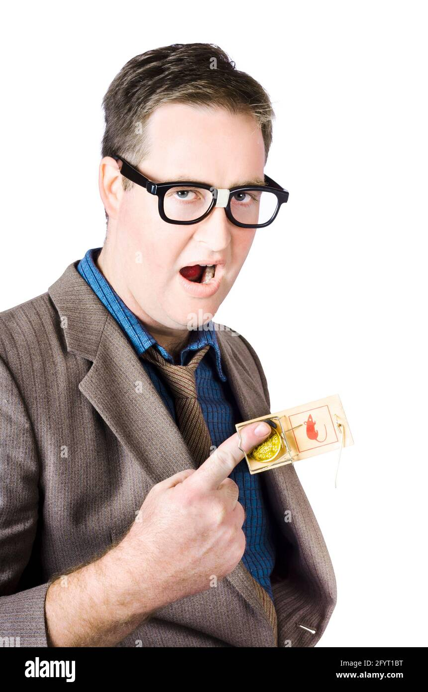 Businessman's Finger With Coin Caught In Mousetrap Stock Photo