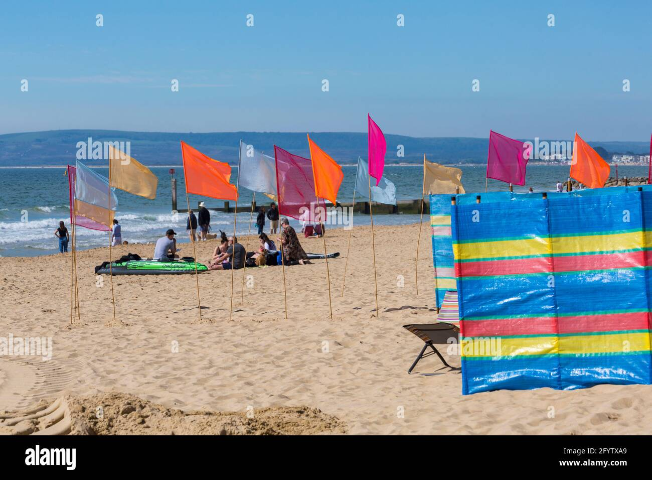 Bournemouth, Dorset UK. 30th May 2021. UK weather: hot and sunny at Bournemouth beaches, as people flock to the seaside to enjoy the sunshine for Bank Holiday Sunday, as more people take staycations because of restrictions on foreign travel due to Covid.  Credit: Carolyn Jenkins/Alamy Live News Stock Photo