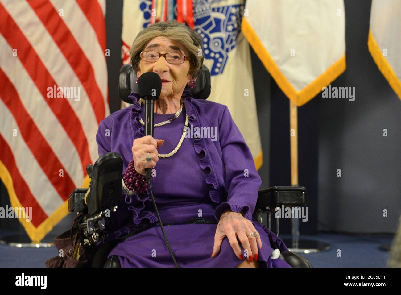 Reportage:   World War II Army veteran 106-year-old Alyce Dixon talks about her experiences as a member of the Women's Army Corps, during a women's history month event at the Pentagon, March 31, 2014. Dixon was honored with a Department of the Army Lifetime Achievement Women of Character, Courage and Commitment award, and a Women's History Month certificate of appreciation. During World War II, Dixon served in Europe as a member of the 6888th Central Postal Directory Battalion. The 6888th was the only unit of African-American women in the WAC to serve overseas in England and France during Worl Stock Photo