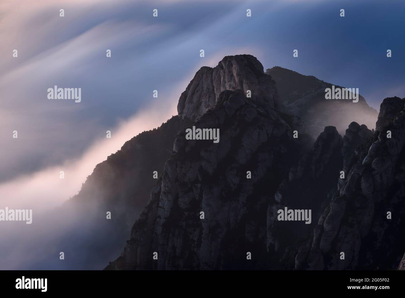 Creu de Sant Miquel Vewpoint, in Montserrat, at night, with a night sea of clouds - fog (Barcelona, Catalonia, Spain) Stock Photo