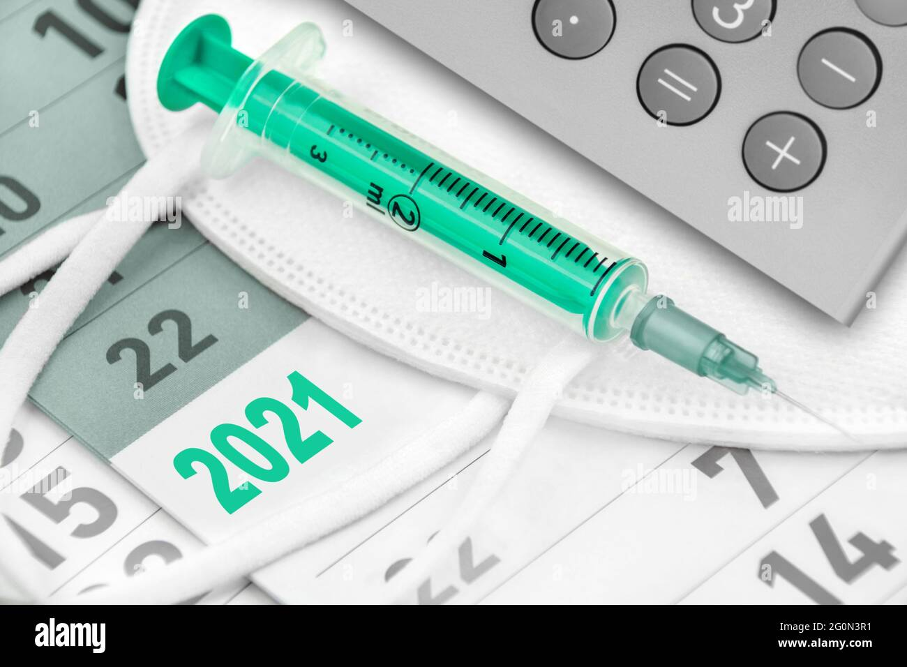 Calendar 2021 FFP2 Mask and Vaccination with calculator Stock Photo