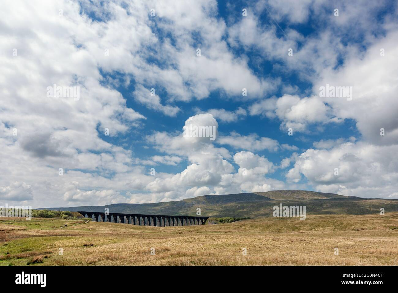 Stunning panoramic view of Whernside with the Ribblehead Viaduct on a sunny day, Yorkshire Dales National Park, UK Stock Photo