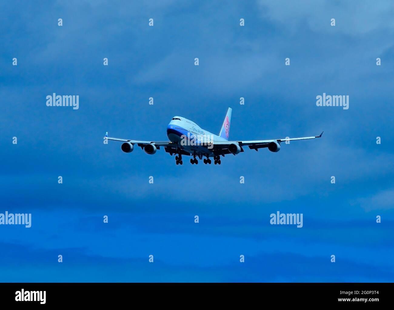 China Airlines Boeing B-747-400, B-18210, Landing at Naha Airport, Okinawa, Japan Stock Photo
