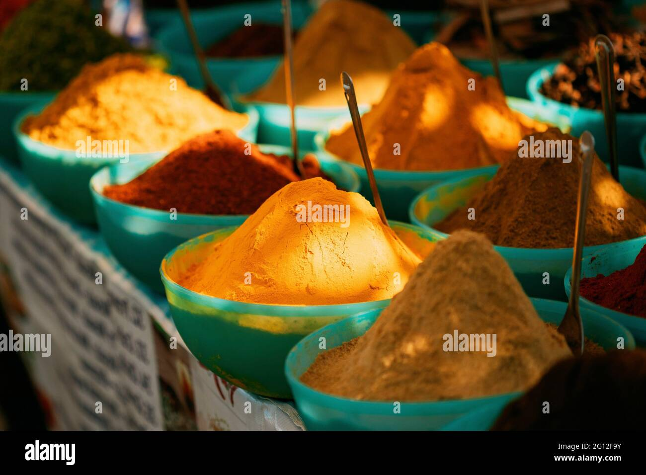 Close View Of Masala Curry, Bright Colors Fragrant Seasoning, Condiment In Tray On Local Food Market, Bazaar. Stock Photo