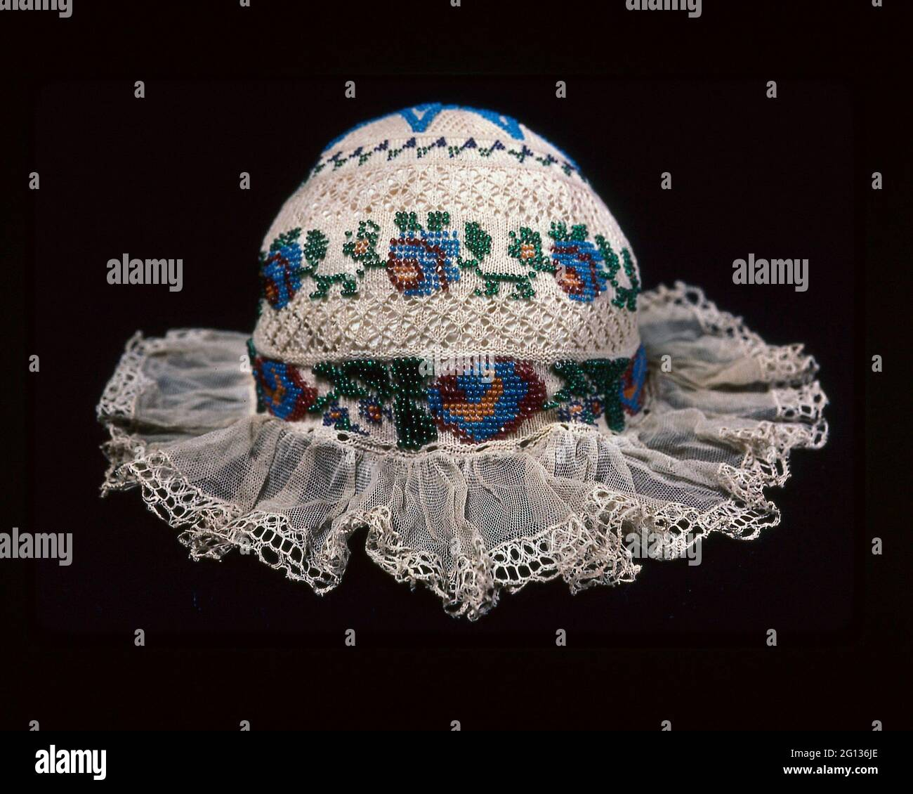 Child - s Cap - 19th century - Europe. Cotton, plain knitting with cotton bobbin lace; edged with linen bobbin lace; cotton, plain weave ties; glass Stock Photo