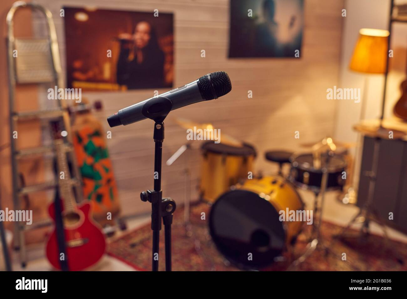 Microphone among musical instruments in sound recording studio Stock Photo
