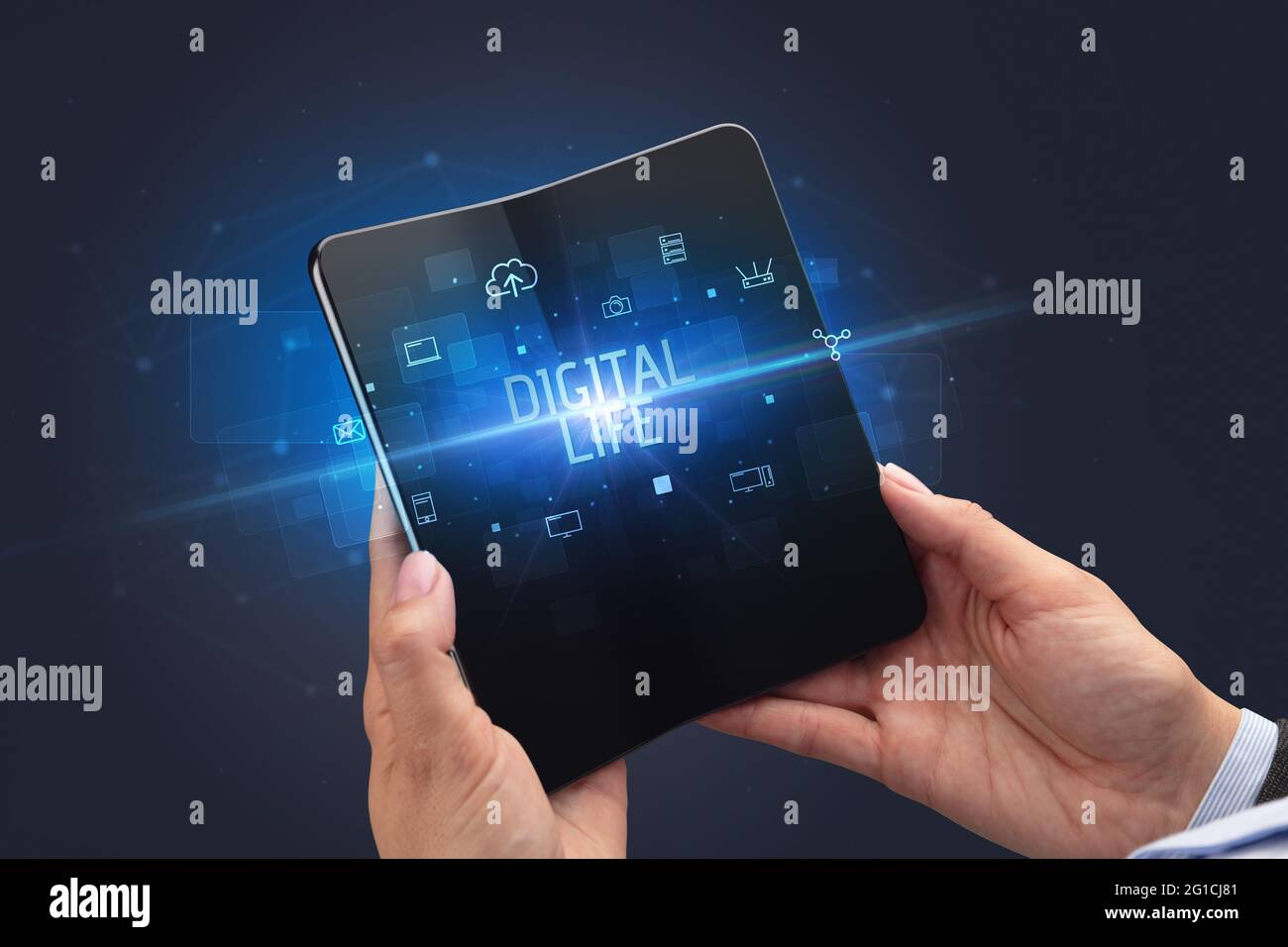 Businessman holding a foldable smartphone, security concept Stock Photo