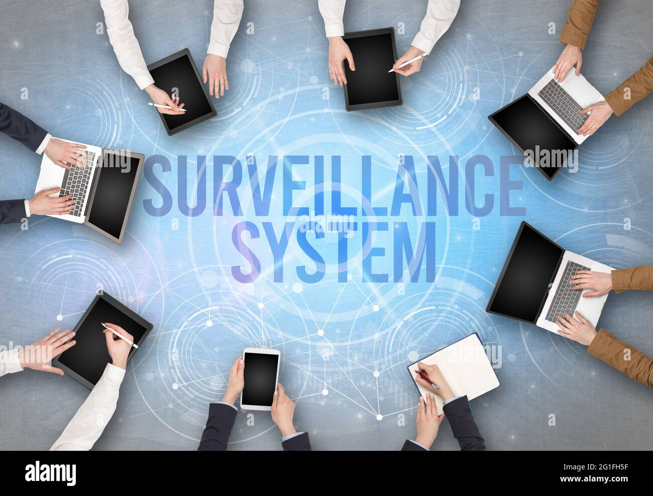 Group of people in front of a laptop, security concept Stock Photo