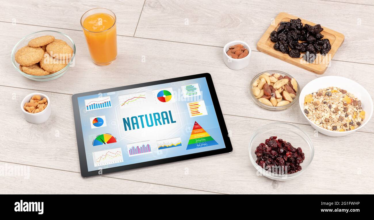 Organic food and tablet pc Stock Photo