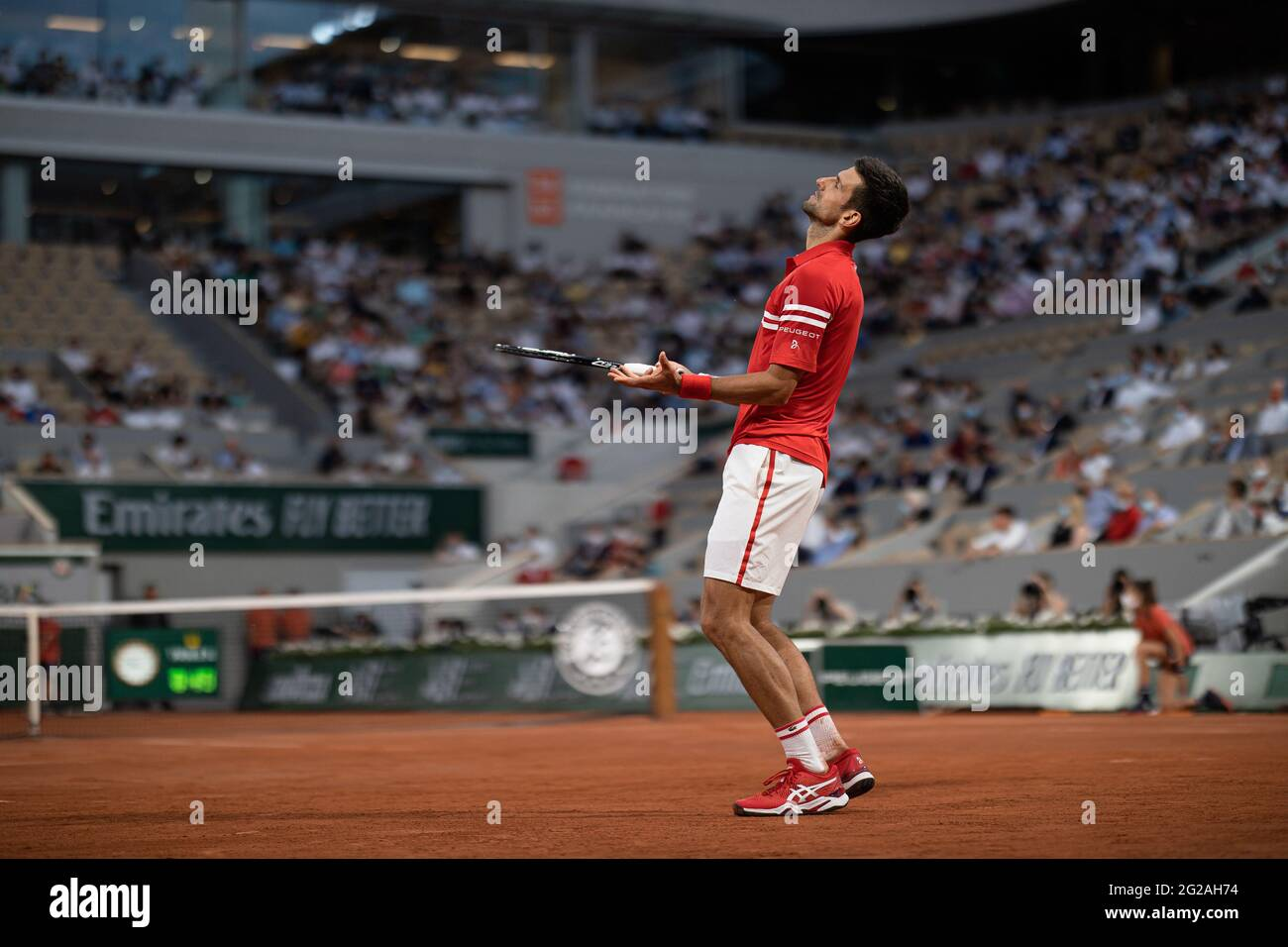 Paris, France. 9th June, 2021. Novak Djokovic of Serbia reacts during the men's singles quarterfinal against Matteo Berrettini of Italy at the French Open tennis tournament at Roland Garros in Paris, France, June 9, 2021. Credit: Aurelien Morissard/Xinhua/Alamy Live News Stock Photo