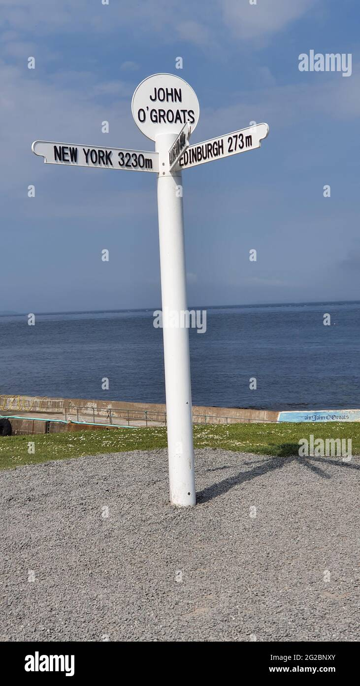 Famous signpost at John O'Groats, the most northerly point on the mainland of, showing distances to New York, Edinburgh, Land's End, Orkney and Shetla Stock Photo