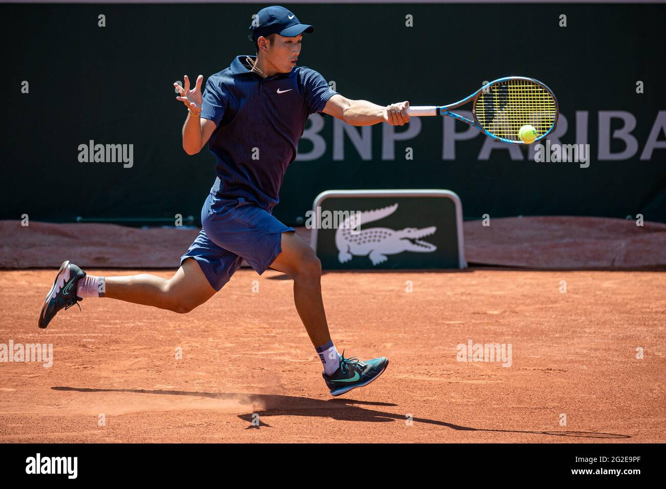 Paris, France. 10th June, 2021. Shang Juncheng of China returns the ball during the boys' singles quarterfinal match between Shang Juncheng of China and Sean Cuenin of France at the French Open tennis tournament at Roland Garros in Paris, France, June 10, 2021. Credit: Aurelien Morissard/Xinhua/Alamy Live News Stock Photo