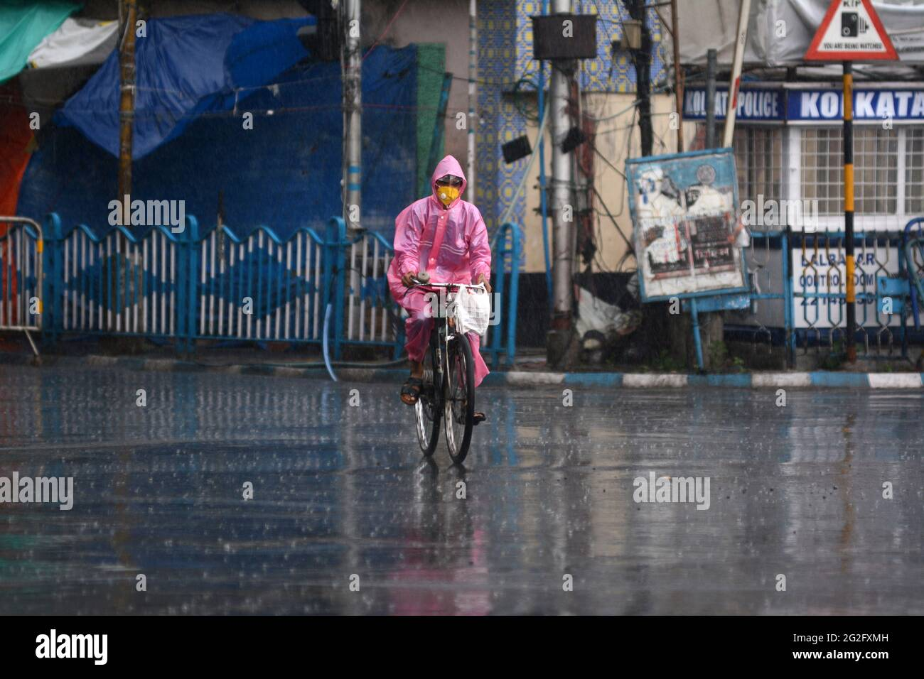 Kolkata, West Bengal, India. 11th June, 2021. A man rides a bicycle as the heavy rainfall lashes Kolkata, India. Credit: Indranil Aditya/ZUMA Wire/Alamy Live News Stock Photo