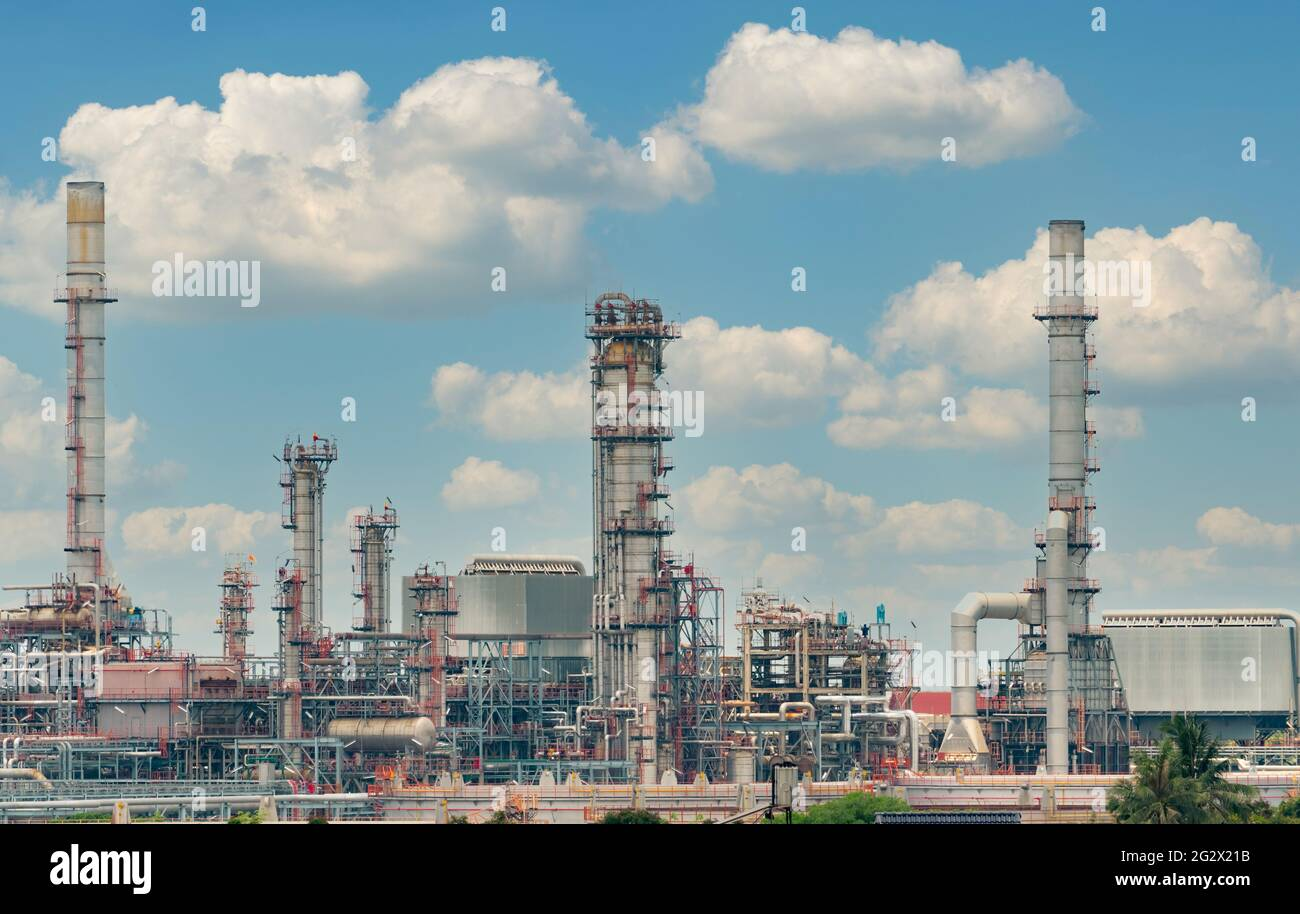 Oil refinery or petroleum refinery plant with blue sky background. Power and energy industry. Oil and gas production plant. Petrochemical industry. Stock Photo