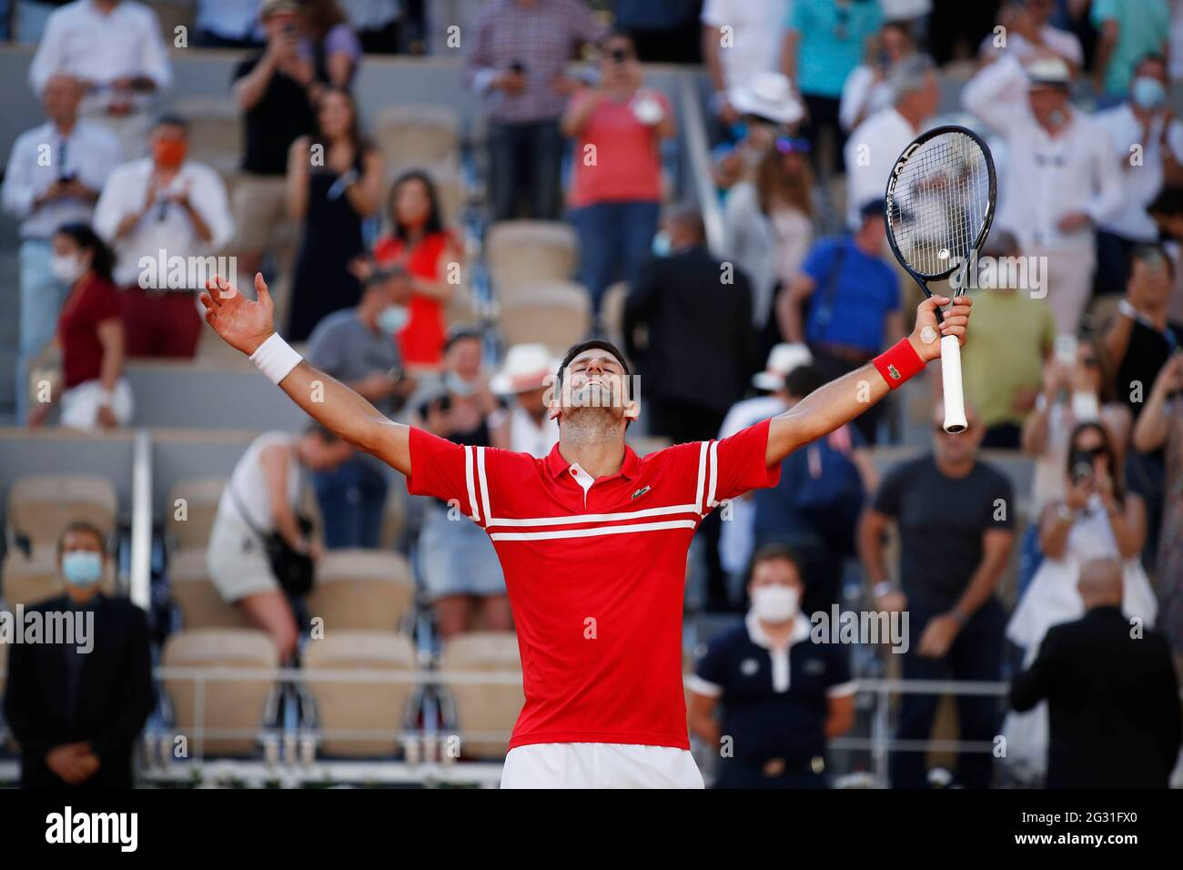 Tennis - French Open - Roland Garros, Paris, France - June 13, 2021 Serbia's Novak Djokovic celebrates winning the final against Greece's Stefanos Tsitsipas REUTERS/Gonzalo Fuentes Stock Photo