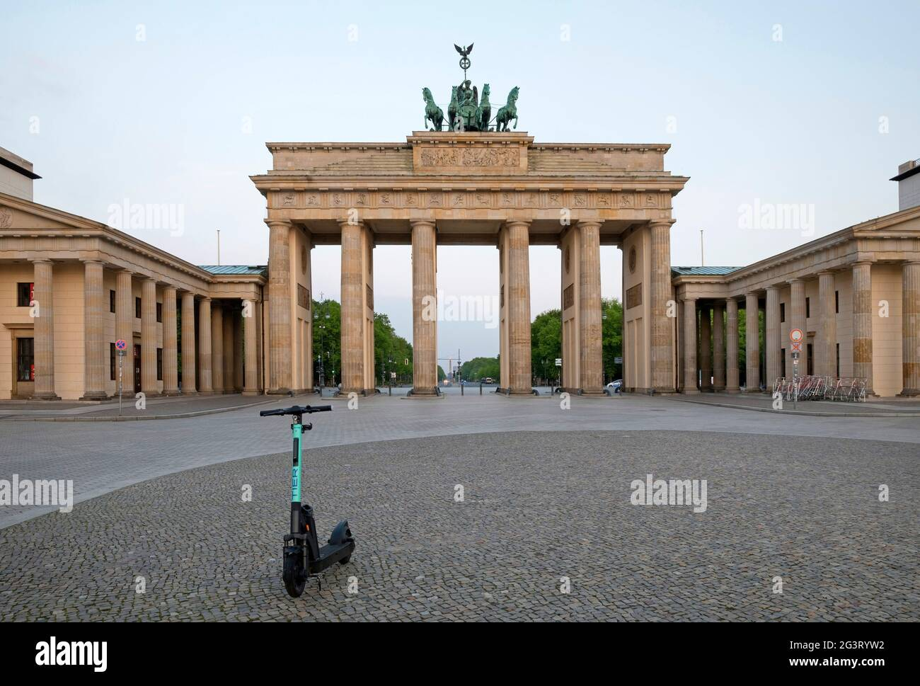 Brandenburger Tor with E-Scooter on Pariser Platz (Paris Square) early in the morning, Germany, Berlin Stock Photo