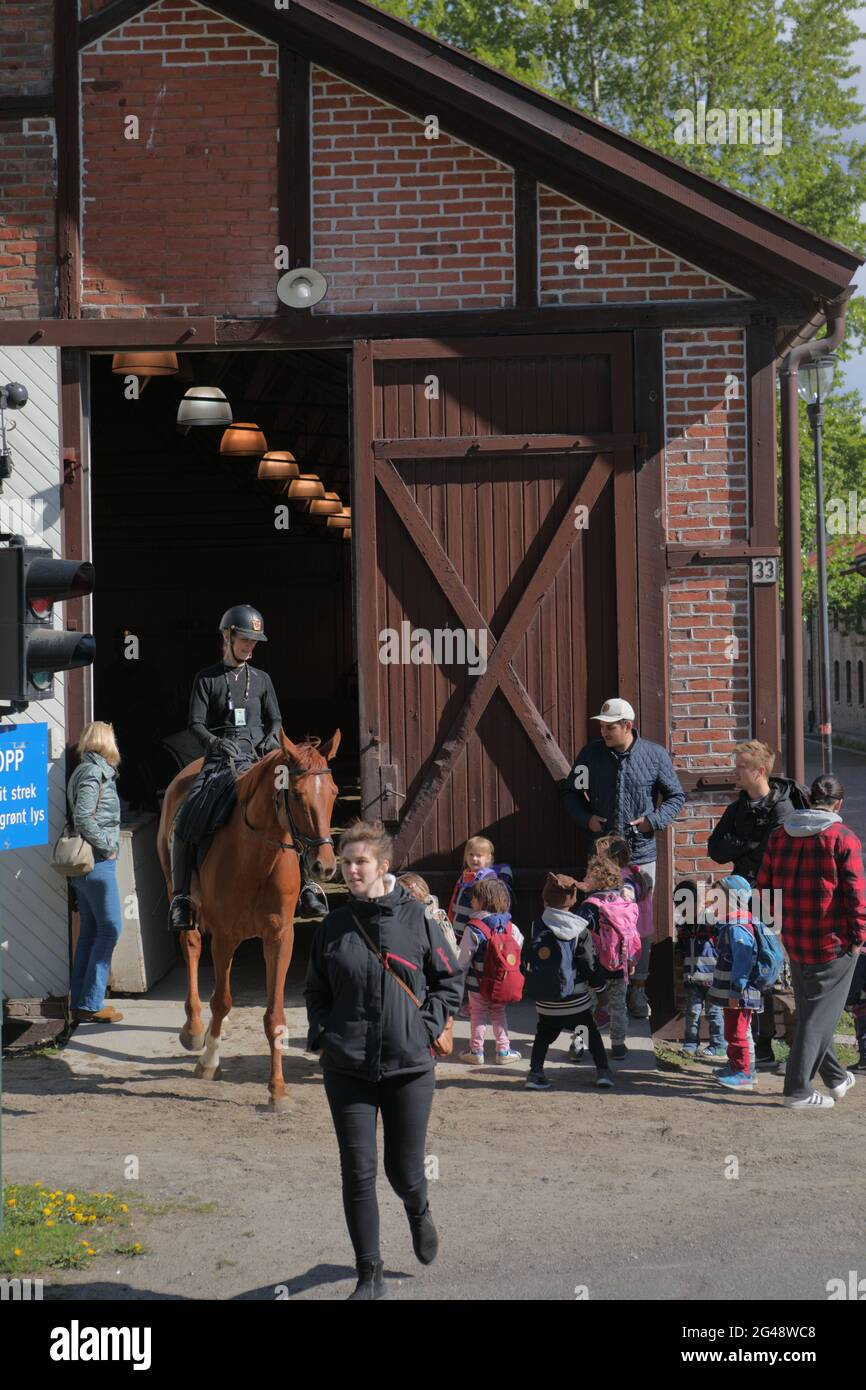 Equestrian and people with children at the riding hall in Myntgata street in Oslo, Norway Stock Photo
