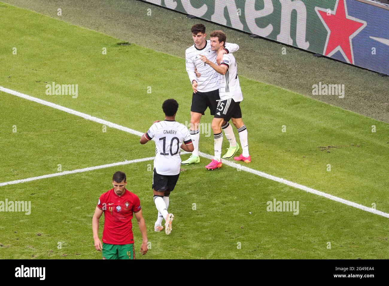 Munich, Germany. 19th June, 2021. Kai Havertz (2nd R) and Thomas Mueller (1st R) of Germany celebrate an own goal from Ruben Dias (1st L) of Portugal during the UEFA Euro 2020 Championship Group F match between Portugal and Germany in Munich, Germany, June 19, 2021. Credit: Shan Yuqi/Xinhua/Alamy Live News Stock Photo