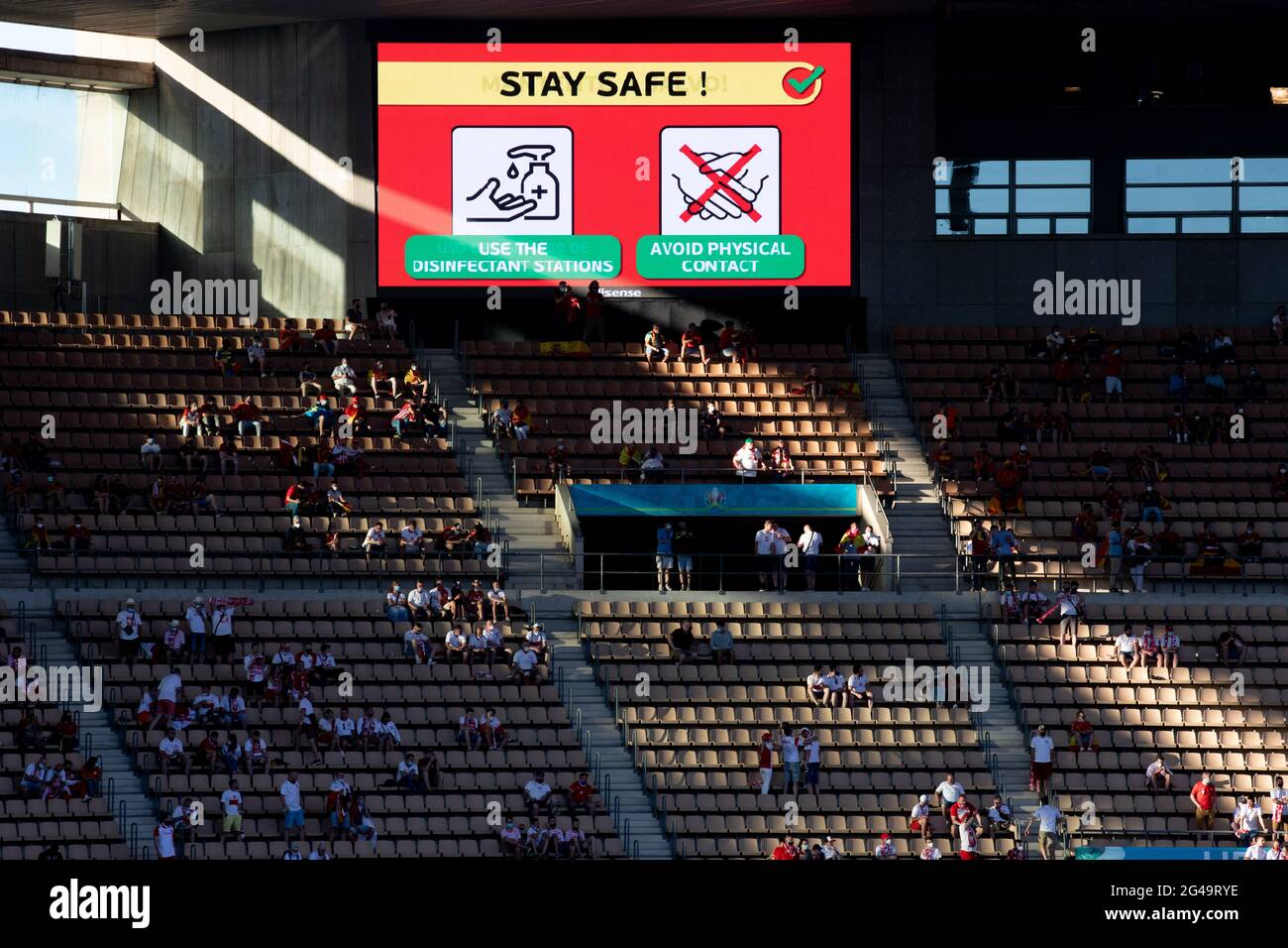 Seville, Spain. 19th June, 2021. The screen written stay safe is seen during the Group E match between Spain and Poland at the UEFA Euro 2020 in Seville, Spain, June 19, 2021. Credit: Meng Dingbo/Xinhua/Alamy Live News Stock Photo