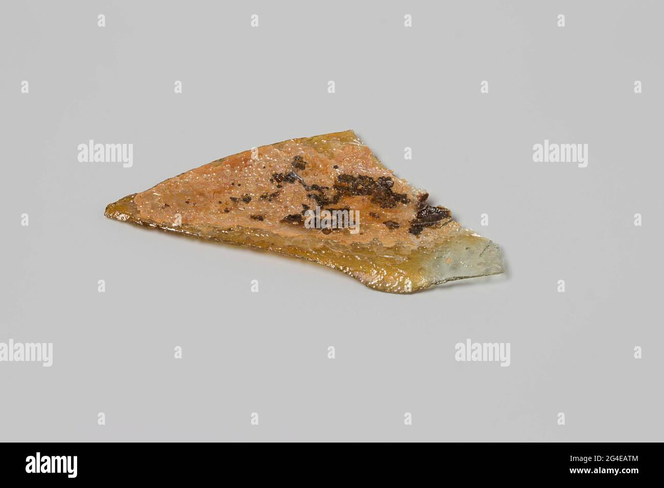 Fragment of a wine bottle from the wreck of the East India Flying Heart. Dispiled glass shard. Stock Photo