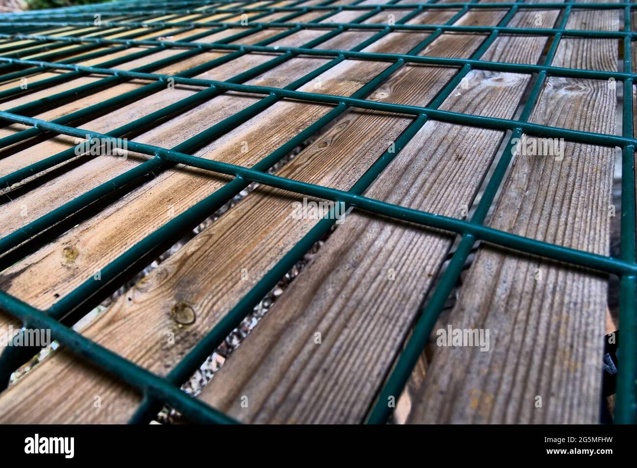 Metal and wood fence, conceptual photography, France Stock Photo