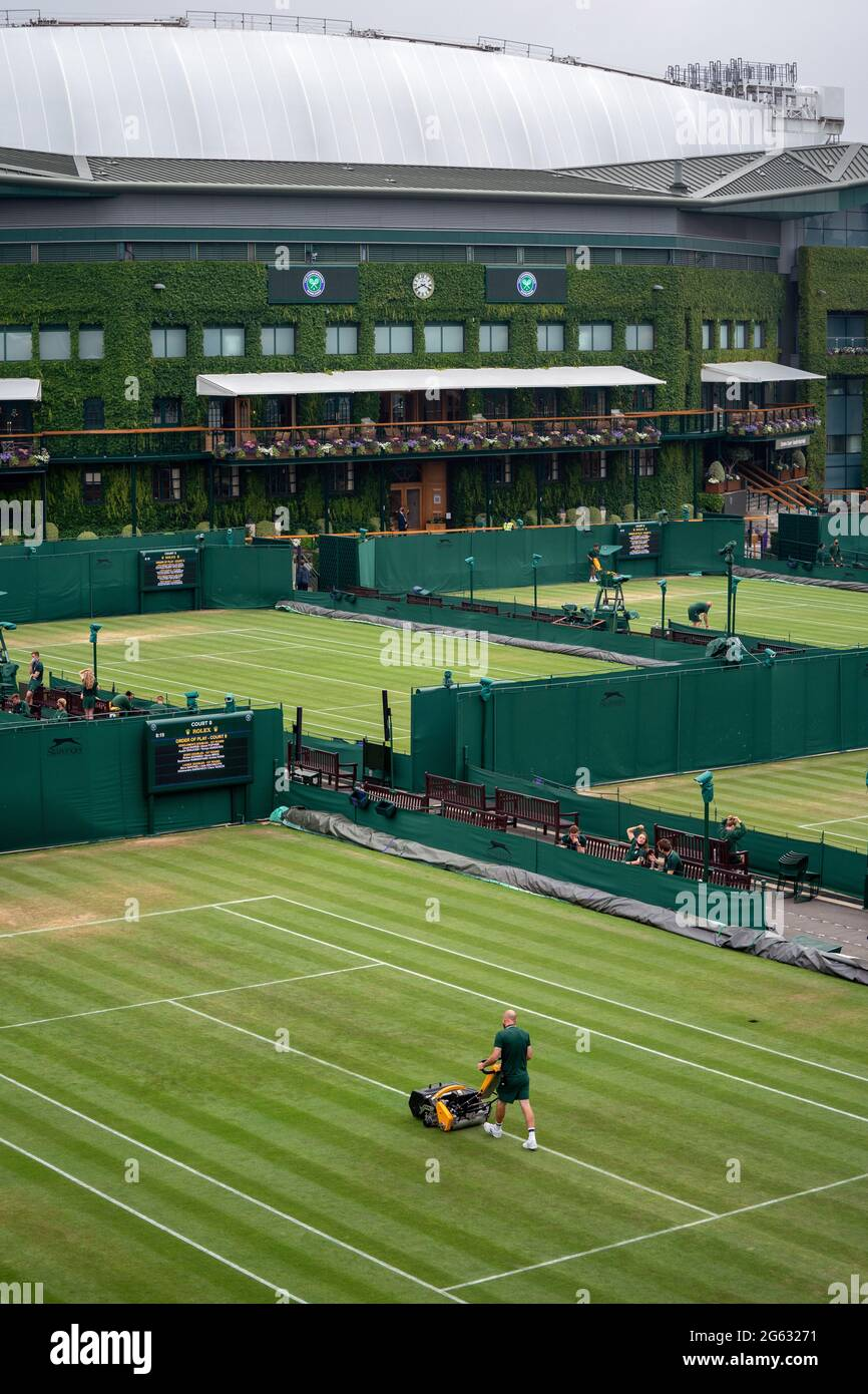 Ground staff prepare courts ahead of day five of Wimbledon