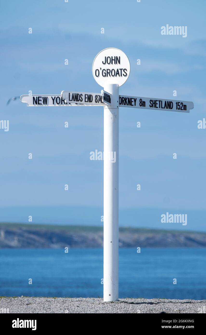 Tourist sign post at John'O Groats,  Caithness Scotland,  the most northerly inhabited place on the British mainland. Stock Photo