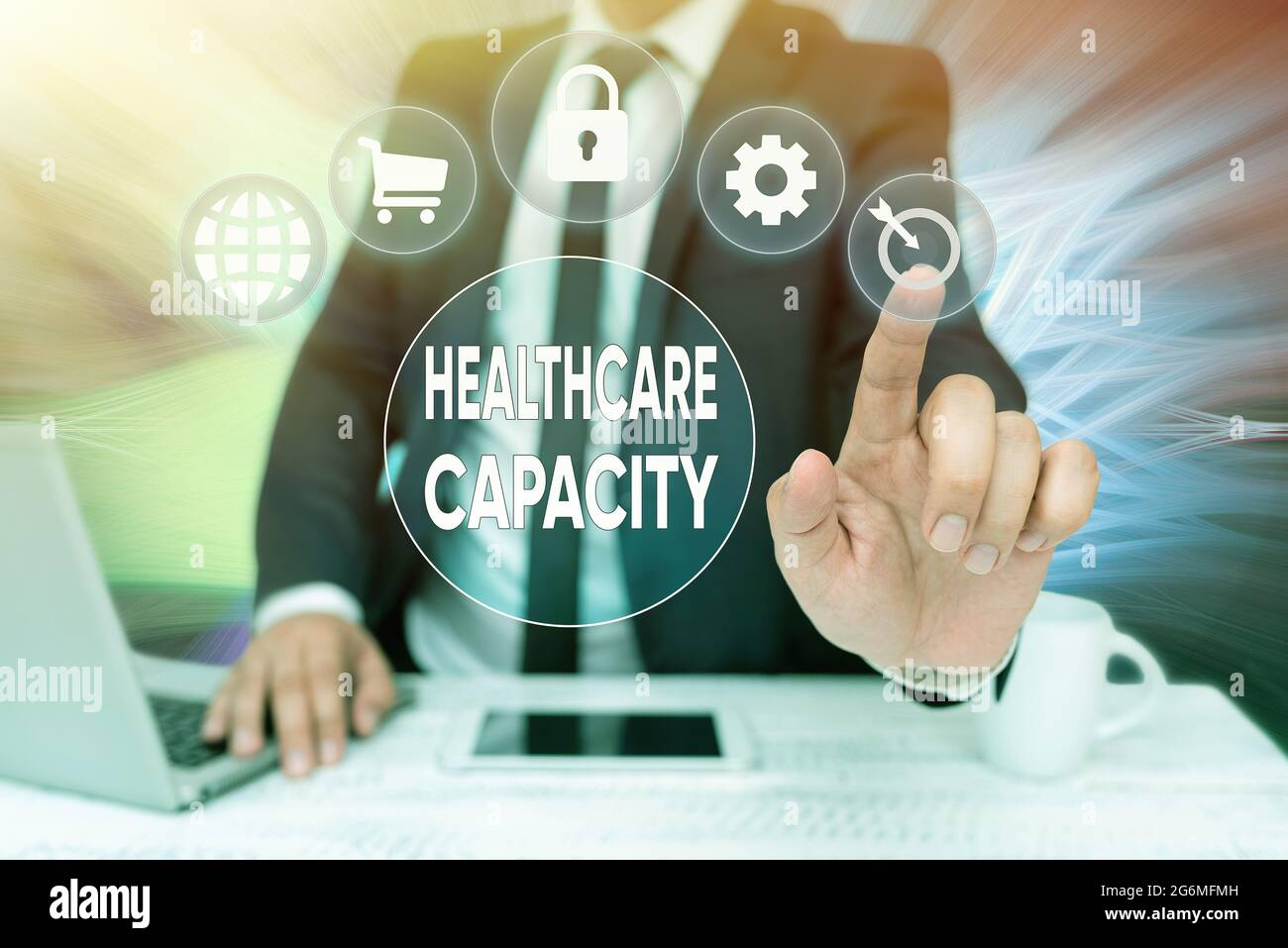Conceptual caption Healthcare Capacity. Concept meaning maximum amount of patients provided with the right medical service Bussiness Man Sitting Desk Stock Photo