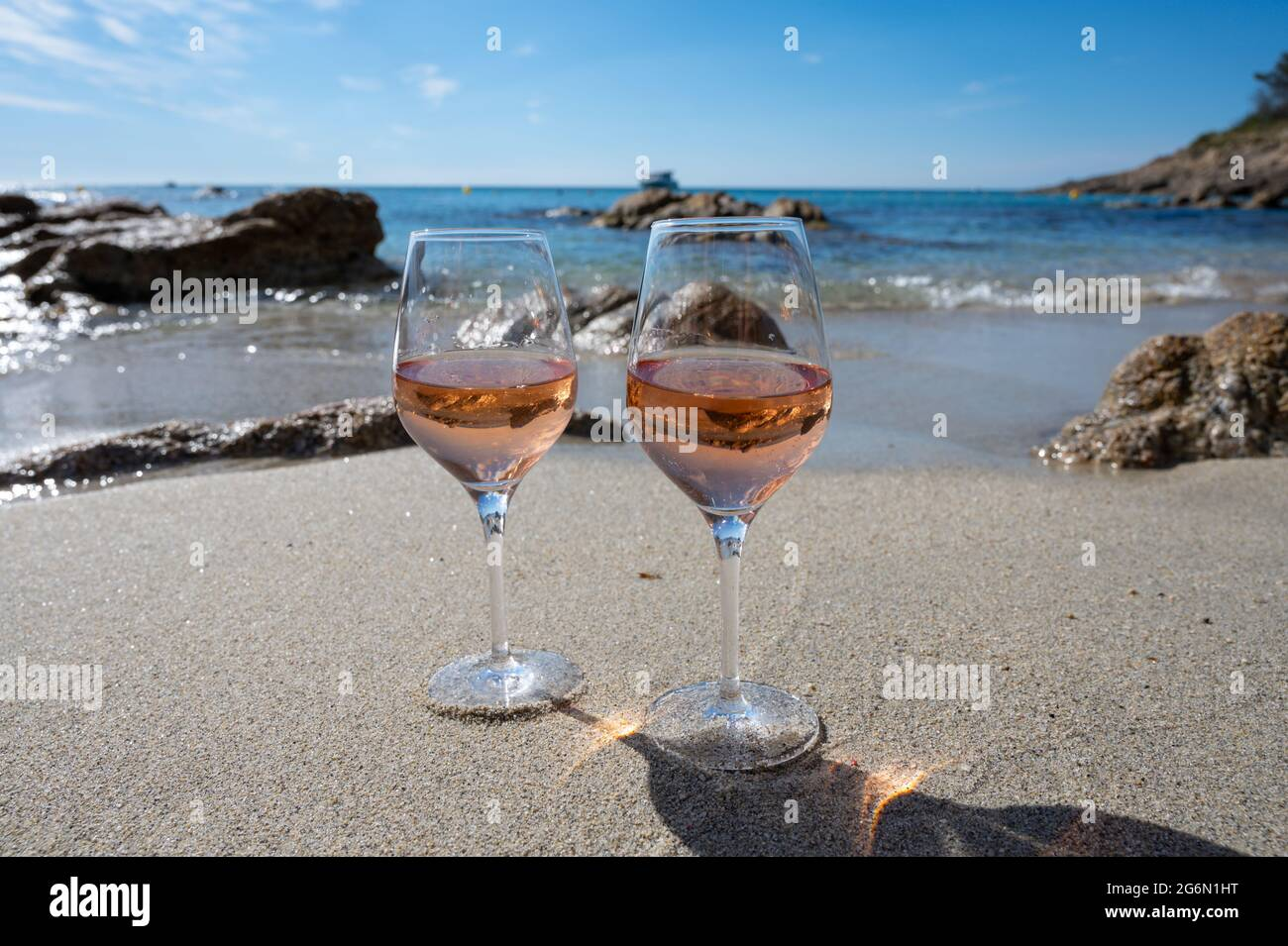 Summer time in Provence, two glasses of cold rose wine on sandy beach near Saint-Tropez in sunny day, Var department, France Stock Photo