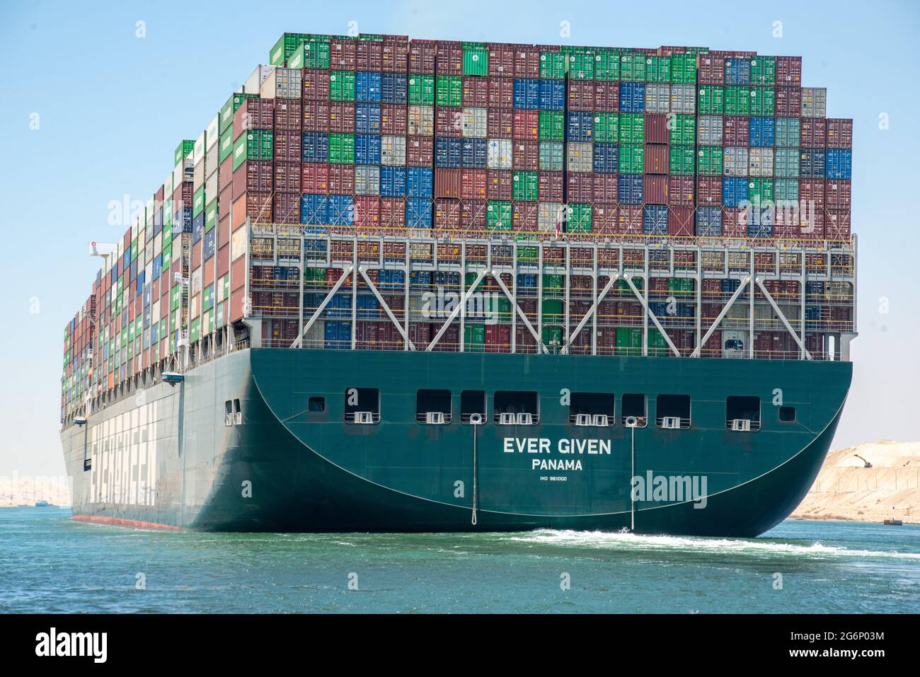 """Suez Canal, Egypt - 7 July 2021 - The huge container ship Ever Given that blocked the Suez Canal  in March 2021 is free at last and enroute to Rotterdam after a compensation agreement was made between the Suez Canal Authority and Shoei Kisen Kaisha, the Japanese ship owners.  The SCA head Osama Rabie declared, """"I announce to the world that we have reached a deal.""""  The Ever Given was freed from blockage in a salvage operation that lasted 6 days, however in that short amount of time it created a traffic jam backlog of 420 ships at the chokepoint in just the first 4 days. Stock Photo"""