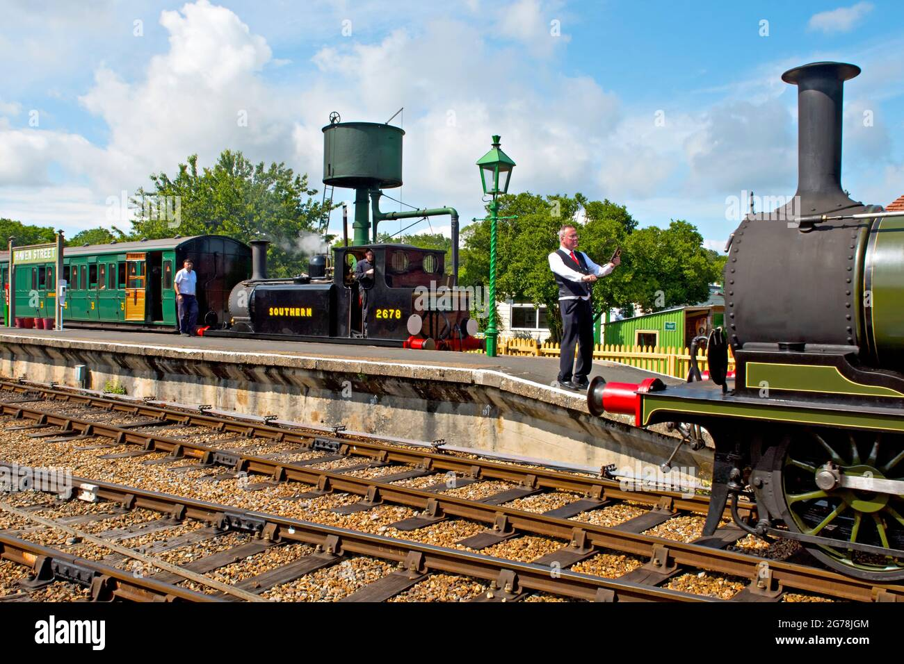 The signalman prepares to exchange single line tokens at Havenstreet station on the Isle of Wight Steam Railway Stock Photo