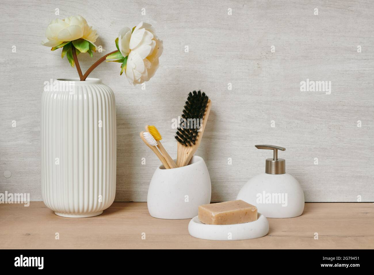 Group of bodycare items against white wall in bathroom Stock Photo