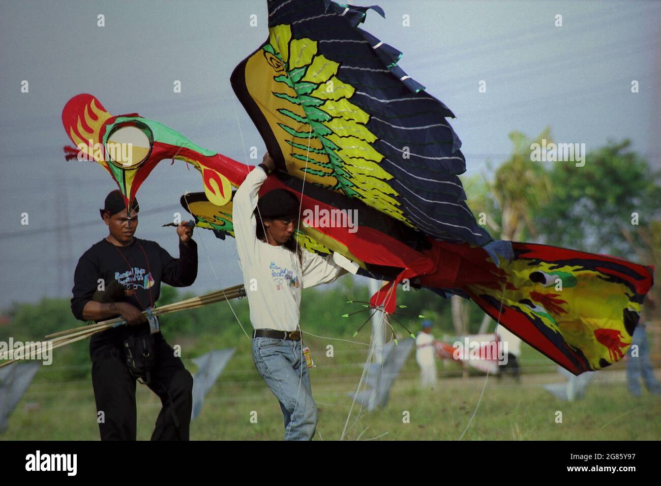 A participant transporting a giant kite that was designed to represent a Garuda during the 2004 Jakarta International Kite Festival that held on July 9-11 at Carnival Beach in Ancol Dreamland, North Jakarta, Jakarta, Indonesia. Stock Photo