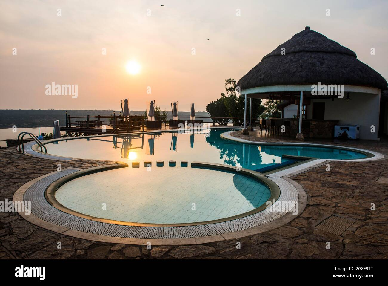 Swimming pool above the Kazinga channel linking lake george and lake Edward at sunset, Queen Elizabeth National Park, Uganda Stock Photo