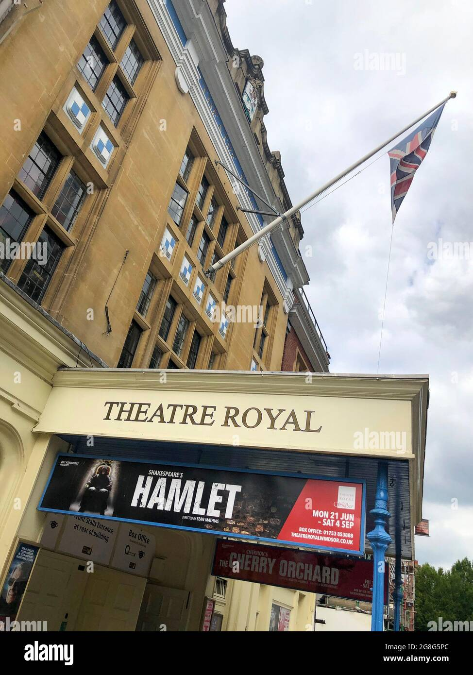 exterior of the Theatre Royal Windsor, England displaying a poster for HAMLET by Shakespeare starring Sir Ian McKellen as the Danish Prince, running from June to September 2021. Directed by Sian Mathias and produced by Bill Kenwright this is a reimagined age, colour blind and gender blind production. It also stars Jonathan Hyde as Claudius,  Jenny Seagrove as Gertrude, Frances Barber as Polonius and Alis Wyn Davies as Ophelia with set design by Lee Newby, costumes by Loren Epstein, wigs & make-up by Susanna Peretz  and lighting by Zoe Spurr . Stock Photo