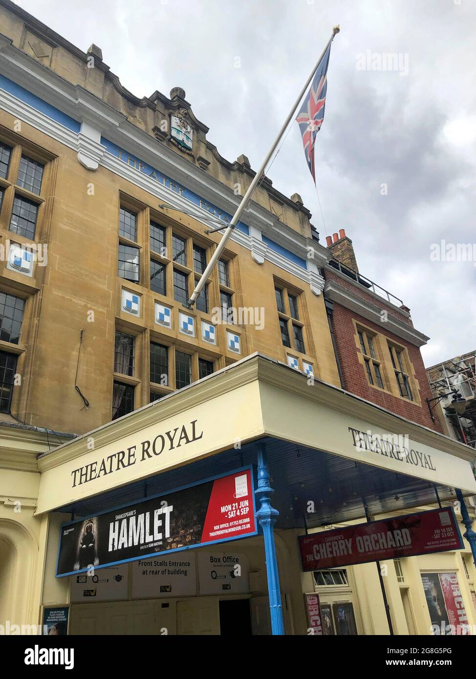 exterior of the Theatre Royal Windsor, England displaying a poster for HAMLET by Shakespeare starring Sir Ian McKellen as the Danish Prince, running from June to September 2021. Directed by Sian Mathias and produced by Bill Kenwright this is a reimagined age, colour blind and gender blind production. Stock Photo