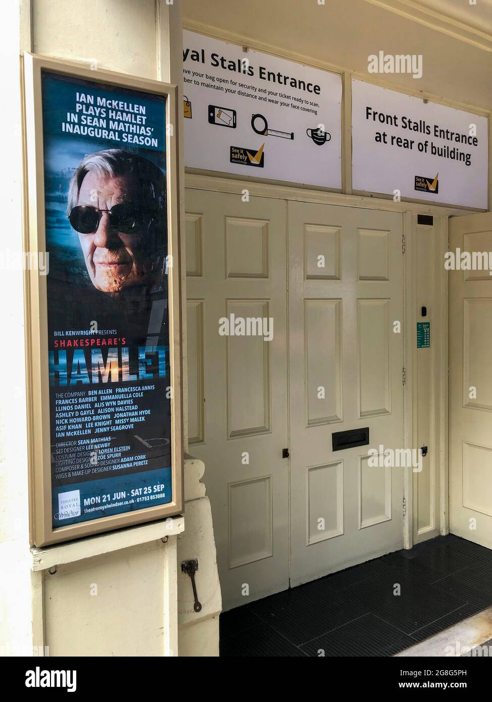 Royal Stalls entrance to the Theatre Royal Windsor, England displaying a poster for HAMLET by Shakespeare starring Sir Ian McKellen as the Danish Prince, running from June to September 2021. Directed by Sian Mathias and produced by Bill Kenwright this is a reimagined age, colour blind and gender blind production. Stock Photo