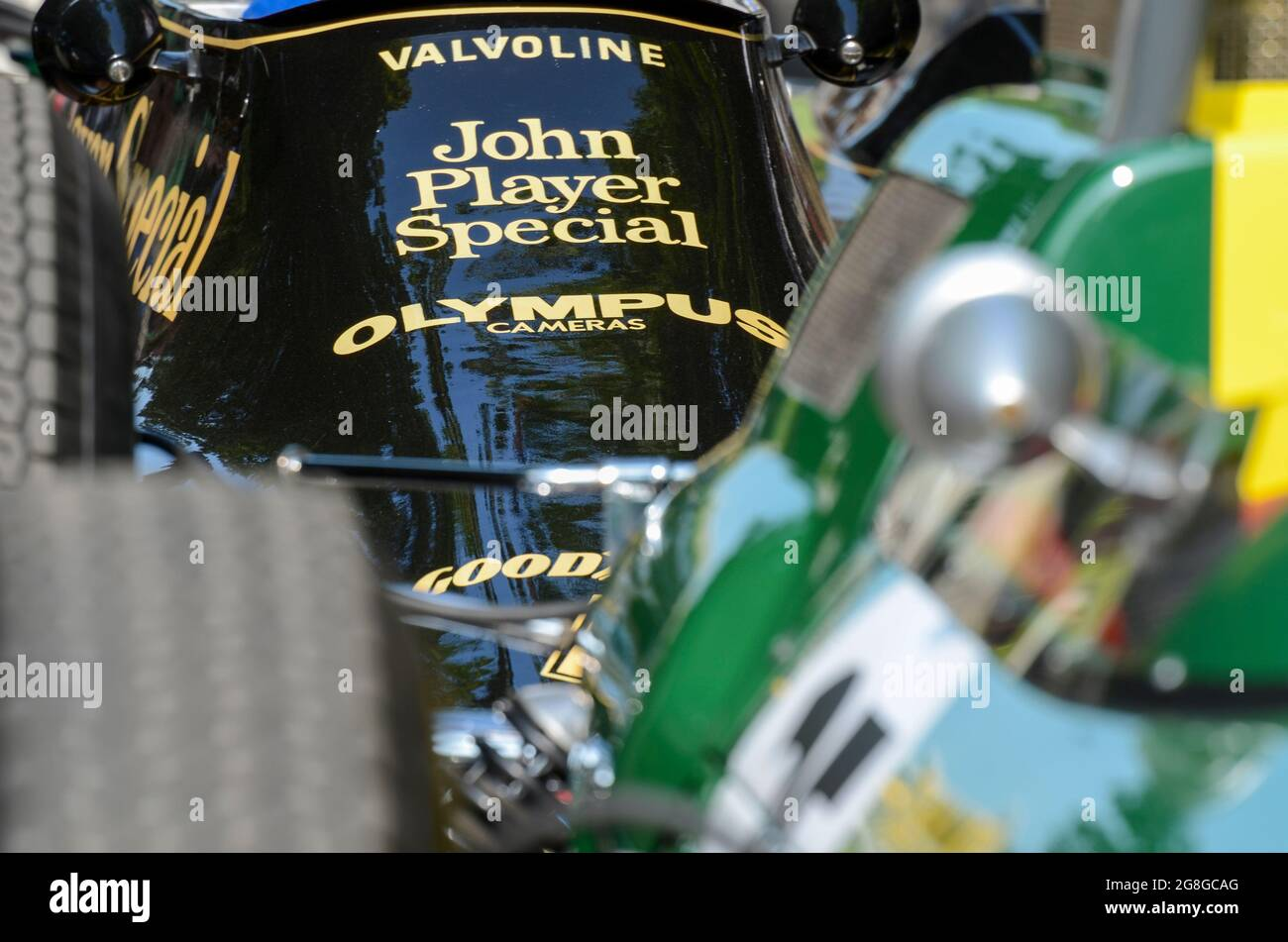 Detail of a 1970s Lotus 79 with John Player Special sponsorship behind a 1960s vintage green Lotus at the Goodwood Festival of Speed event, UK Stock Photo