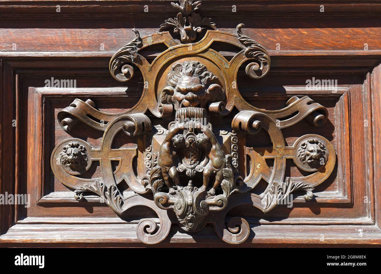 European Vintage old metal wrought iron door knocker. Design detail. Paris. Stock Photo