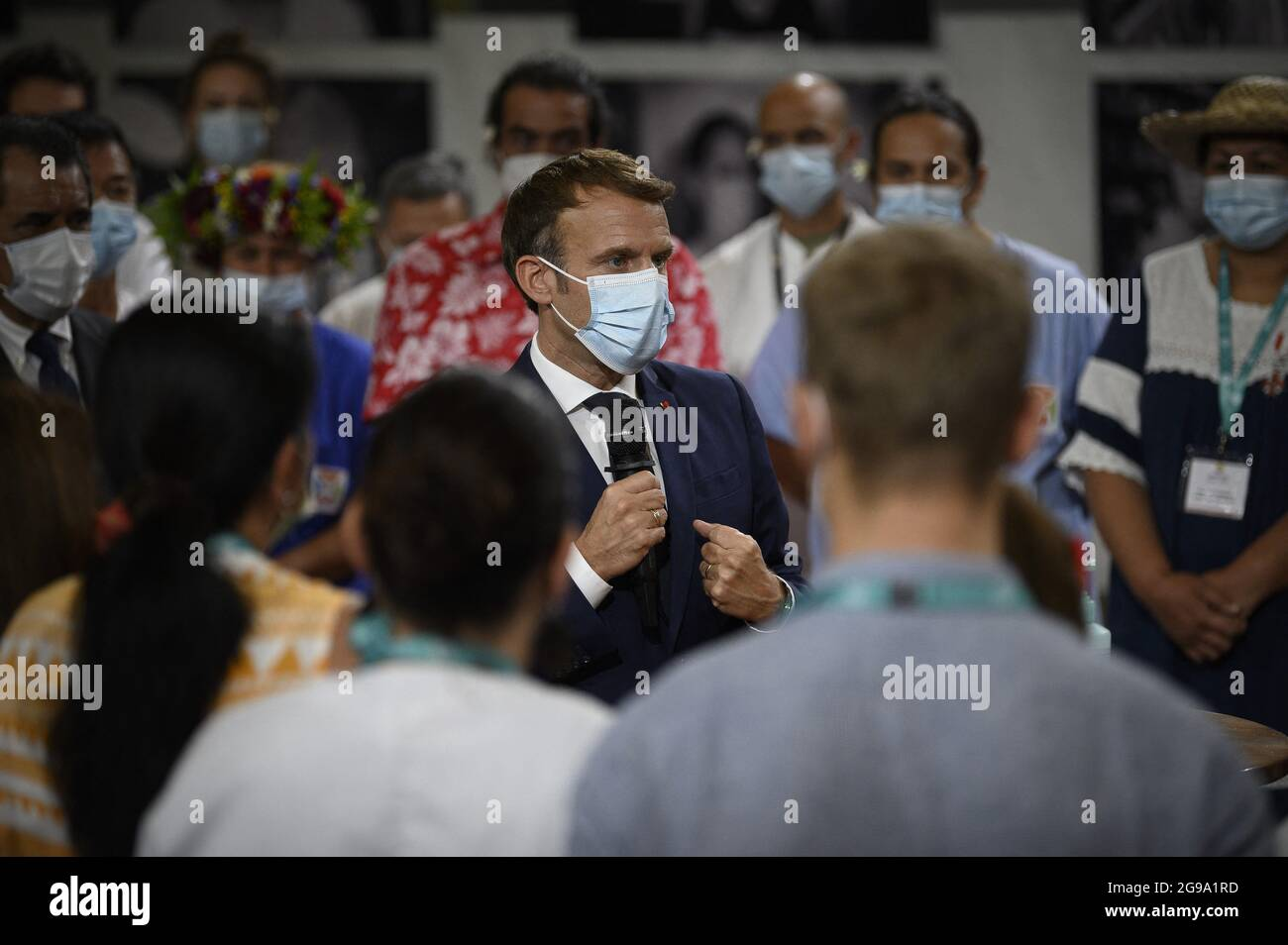 France's President Emmanuel Macron (C) speaks with doctors and nurses working at the French Polynesia Hospital Centre in Papeete following his arrival for a visit to Tahiti in French Polynesia on July 24, 2021. Photo by Eliot Blondet/ABACAPRESS.COM Stock Photo