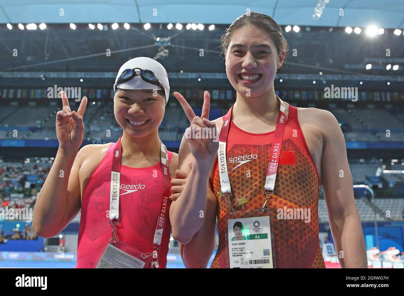 Tokyo, Japan. 28th July, 2021. Zhang Yufei (R) and Yu Liyan of China pose after the women's 200m butterfly semifinal at the Tokyo 2020 Olympic Games in Tokyo, Japan, July 28, 2021. Credit: Ding Xu/Xinhua/Alamy Live News Stock Photo