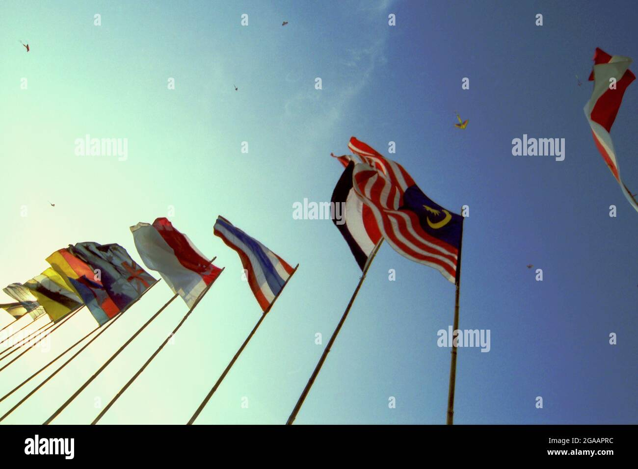 Flags of participating countries during the 2004 Jakarta International Kite Festival that held on July 9-11 at Carnival Beach in Ancol Dreamland, North Jakarta, Jakarta, Indonesia. Stock Photo