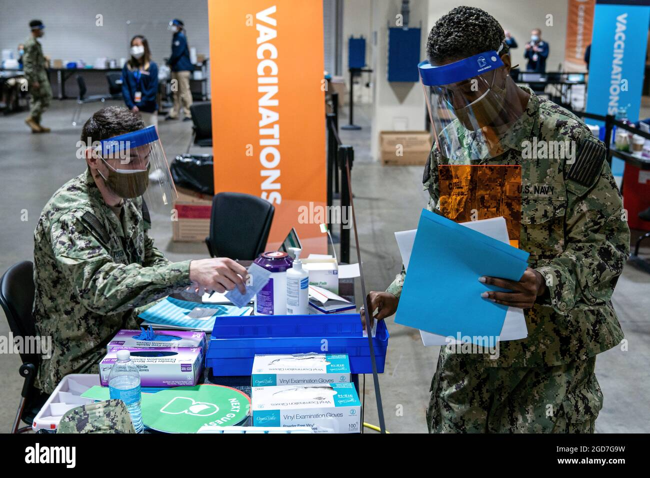 U.S. Navy Hospitalman Matthew Tuten (left), a native of Wichita Falls, Texas, and U.S. Navy Hospitalman Kenecha Campbell (right), a native of Orlando, Florida, assigned to Naval Medical Center Portsmouth, Virginia, refill COVID-19 vaccine supplies at their assigned stations at the Hynes Convention Center COVID-19 Community Vaccine Center in Boston, April 2, 2021. U.S. Navy Sailors from across the country are deployed in support of Department of Defense federal vaccine response efforts. U.S. Northern Command, through U.S. Army North, remains committed to providing continued, flexible DoD suppor Stock Photo