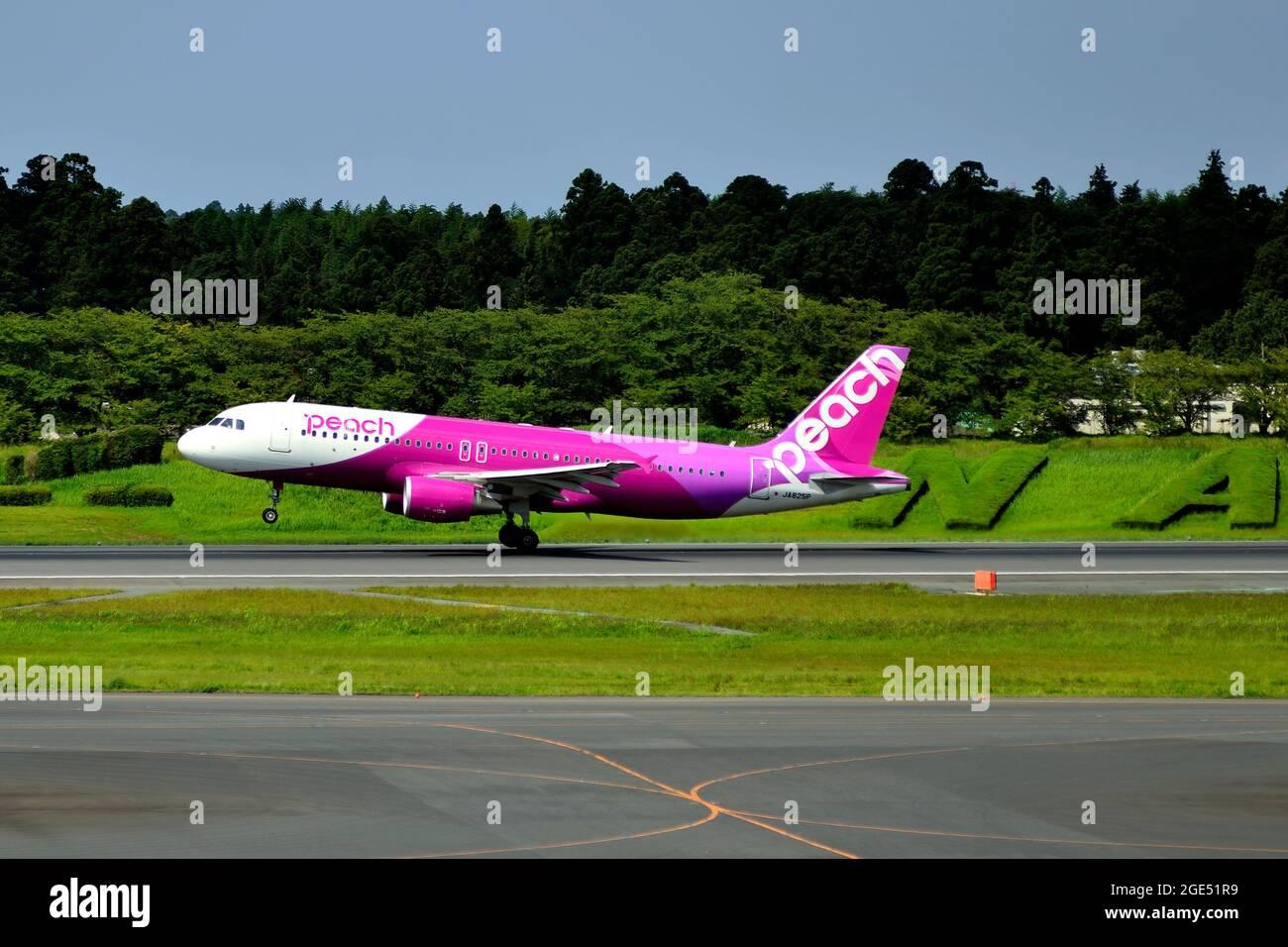 Peach Aviation, Airbus, A320 CEO, JA825, Take Off, Narita Sign Behind, Tokyo Narita Airport, Chiba, Japan Stock Photo
