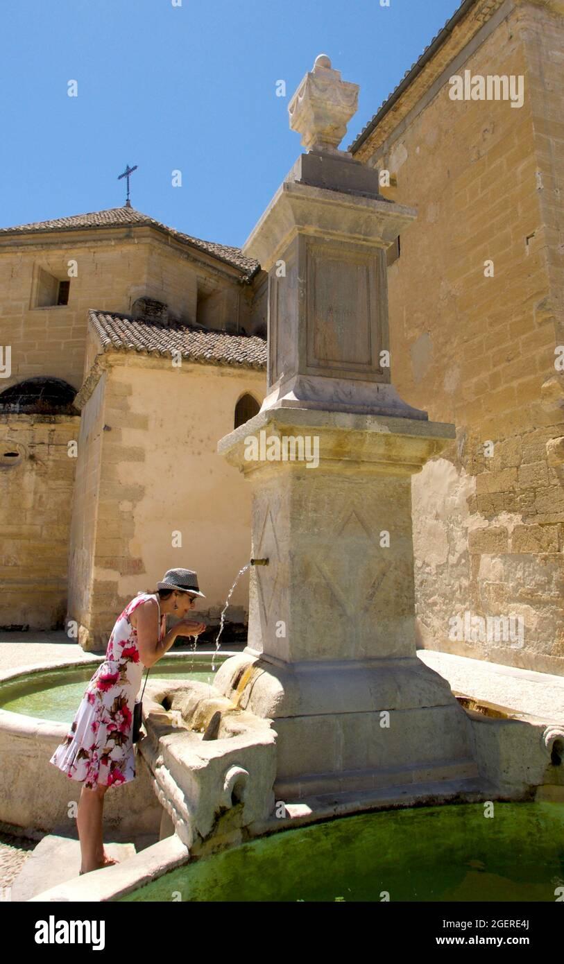 Woman drinking from fountain Alhama de Granada Stock Photo