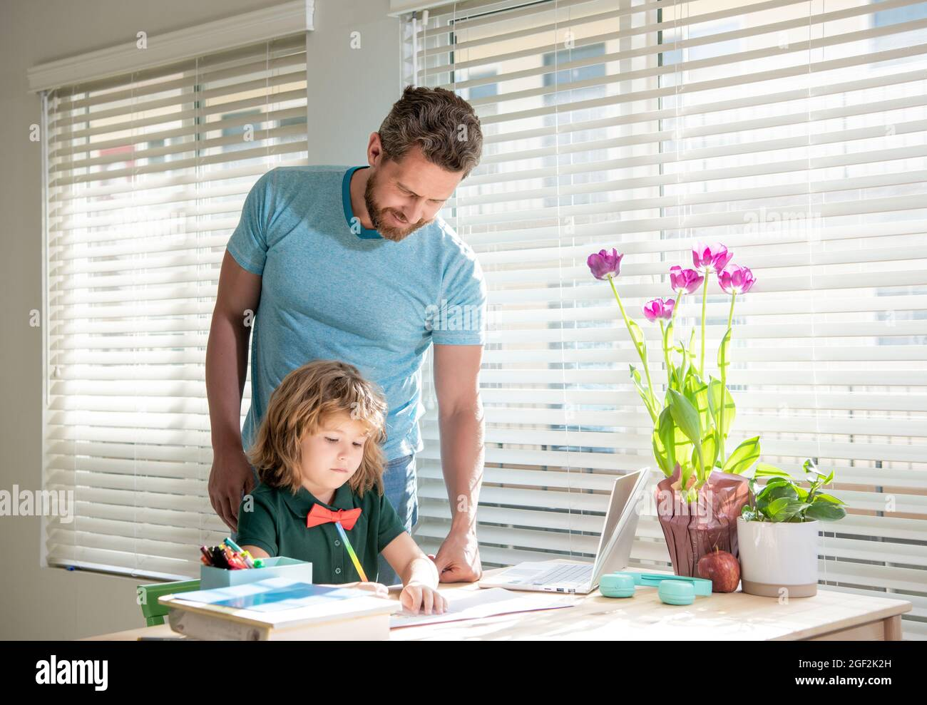 boy study with teacher. private drawing lesson. education concept. homeschooling and help. Stock Photo