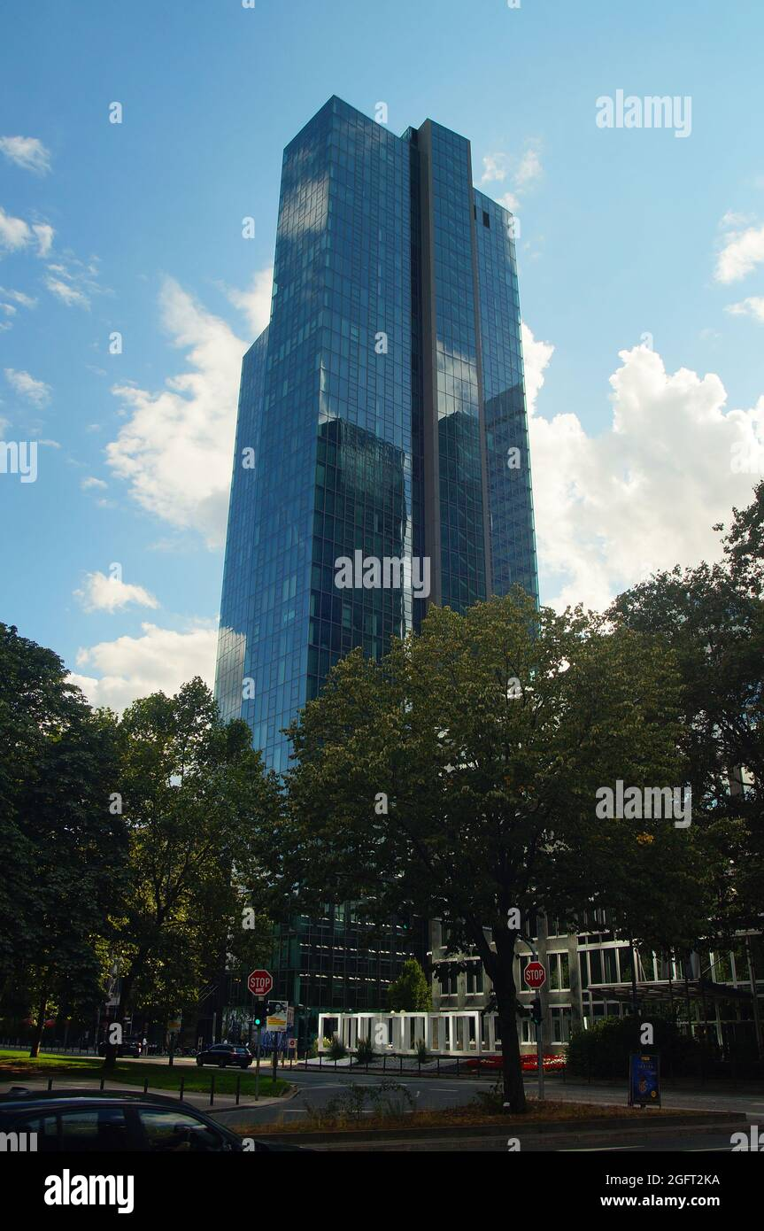 FRANKFURT, GERMANY - Aug 20, 2021: The Gallileo tower in Frankfurt in backlight. Blue cloudy sky with nice reflections on the glass facade. Built by D Stock Photo